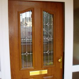Traditional oak effect composite front door