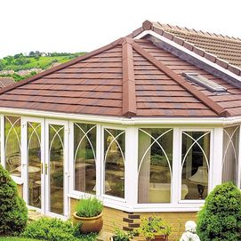 Custom made conservatory with insulated tiled roof